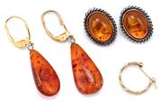 Sale 9083 - Lot 319 - TWO PAIRS OF RECONSTITUTED AMBER EARRINGS AND A GOLD HOOP; a pair pendeloque drops on gold plated fittings, length 45mm, a pair of o...