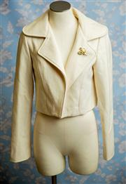 Sale 8577 - Lot 137 - A vintage cream woollen and viscose crop jacket with vintage brooch and lined, size 10, Condition: Very Good