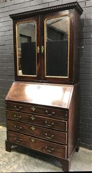 Sale 9031 - Lot 1092 - George III Mahogany Associated Bureau Cabinet, the top with two mirror panel doors, having gilt moulded edge & candle slide, above a...