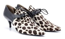 Sale 9186 - Lot 342 - A PAIR OF 90S YVES SAINT LAURENT SHOES; in giraffe print pony hair and black leather, shoes need to be reheeled (incl. spares heels...