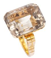 Sale 8915 - Lot 342 - A 14CT GOLD QUARTZ COCKTAIL RING; featuring a step cut smoky quartz of approx. 16.3ct to pierced scrolling gallery and engraved shou...
