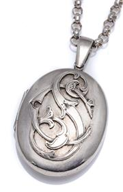 Sale 9012 - Lot 365 - AN ANTIQUE SILVER LOCKET ON CHAIN; 55 x 33mm (including bale) oval locket with applied monogram on a belcher link chain, length 70cm...
