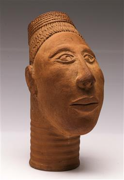 Sale 9119 - Lot 25 - A potted African head signed to base MD (H:28cm)