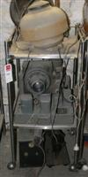 Sale 7670A - Lot 1129 - Stainless steel mobile cabinet with US Army camera together with a vintage heater and a glass lamp shade
