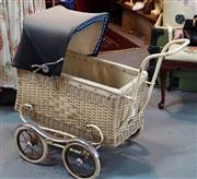 Sale 8320 - Lot 621 - Cane and chrome baby/dolls pram in very good condition with reversible cloth hood circa 1900