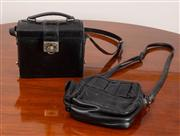 Sale 8774A - Lot 294 - A Satchi Club black leather box style handbag together with an Annuchi black leather shoulder bag.