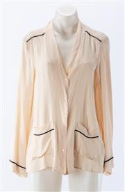 Sale 8910F - Lot 95 - A cream blouse with black trim, by Zara together with a similar black example, both size small