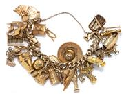Sale 8928 - Lot 333 - A 14CT GOLD CHARM BRACELET; 14ct curb link bracelet to integrated box clasp and safety chain attached with 27 charms incl. 8 x 18ct,...