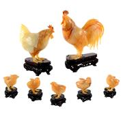 Sale 8000 - Lot 70 - An agate family group of rooster, hen and chicks on fitted wooden stands.