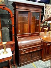 Sale 8693 - Lot 1095 - Late Victorian Walnut Cylinder Bookcase, with two glass panel doors above, fitted below with a door & one long & two short drawers (...