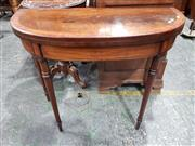 Sale 8714 - Lot 1008 - George III Mahogany Card Table, with cross-banded demi-lune top on turned gate-legs
