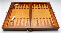 Sale 9164 - Lot 21 - A well crafted timber backgammon set with fold out timber legs (W:45cm L:60cm)