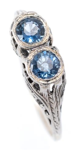 Sale 9169 - Lot 352 - AN EDWARDIAN STYLE SILVER SAPPHIRE RING; set with 2 round cut blue sapphire in decorative pierced mount and gallery, width 5.8mm, si...