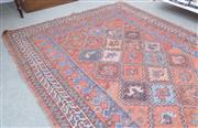 Sale 8440A - Lot 40 - A geometric rug on red ground with horse and rider motif, 190 x 130cm