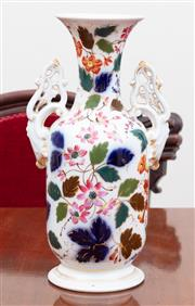 Sale 8908H - Lot 61 - A Continental twin handled vase of baluster form profusely decorated with florals. Height 33cm