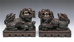 Sale 9093P - Lot 2 - Good Pair of Chinese Hardwood Carved Dogs of Foo with Glass Eyes (19 x 22 cm)