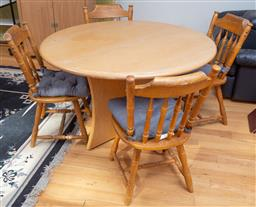 Sale 9190H - Lot 469 - A round wooden dining table with four chairs. Height of table 76cm Diameter 119cm