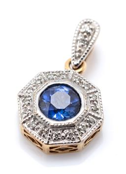 Sale 9221 - Lot 324 - A 9CT GOLD DIAMOND AND STONE SET ENHANCER PENDANT; centring a round cut synthetic blue sapphire to octagonal surround and bail set w...