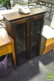 Sale 8227 - Lot 1088 - Timber CD Cabinet with Glass Panel Doors
