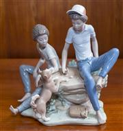Sale 8313A - Lot 72 - A Lladro figural group of two boys and a puppy playing dice, incised 5379, height 22cm