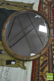 Sale 8390 - Lot 1025 - Chinese Carved Rosewood Mirror, of oval form simulating bamboo.
