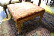 Sale 8520 - Lot 1061 - Victorian Gilt Square Footstool with Needlework Upholstery Showing Lilys on Elaborate Cabriole Legs with Scrollwork and Joined by S...