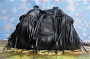 Sale 8577 - Lot 141 - A large black boho style leather Oroton handbag featuring gunmetal hardware and studded detail, weave handle and fringing, brown bub...