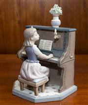 Sale 8313A - Lot 73 - A Lladro figure of a young pianist, number 5469 to base, height 22cm