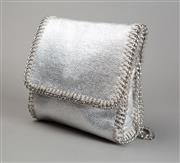 Sale 8499A - Lot 60 - A Witchery shoulder bag in silver painted canvas with silver metal chain strap and edges; unused. Height: 14.5 cm.
