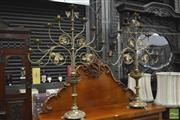 Sale 8345 - Lot 1030 - Impressive Pair of 19th Century Brass Altar Candelabra, each with seven branches & vine leaves, pierced galleries and paw feet