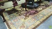 Sale 8345 - Lot 1045 - Indian Agra Wool Carpet, with lotus flowers on a coffee ground (200 x 150cm)