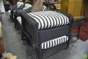 Sale 8338 - Lot 1325 - Suite of Wicker Outdoor Chairs incl. Pair of Rockers, Armchairs, Footstools and a Side Table (7)