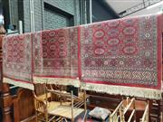 Sale 8925 - Lot 1032 - A pair of bokhara runners & smaller example (232 x 68.5cm / 115 x 68.5cm)