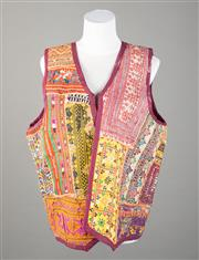 Sale 8499A - Lot 63 - A vintage patchwork vest in purple, orange, red and yellow colours. Size: L.