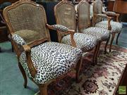 Sale 8539 - Lot 1008 - Set of Four Louis XV Style Chairs, including two armchairs, the carved framed with caned backs & leopard print seats