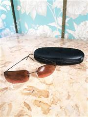 Sale 8577 - Lot 142 - A vintage designer pair of Giorgio Armani sunglasses featuring rose coloured lenses and case, Condition: Excellent