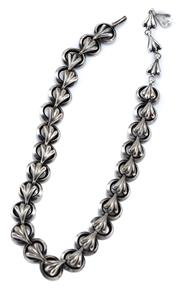 Sale 9054 - Lot 367 - A VINTAGE HANDMADE SILVER NECKLACE; open oval links with fan shape decoration to a hook clasp, adjustable length 34-40cm, wt. 66.91g.