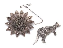 Sale 9107J - Lot 334 - TWO SILVER BROOCHES; one filigree stylised flower with safety chain, width 50mm, other kangaroo with bead and wire work with gilt ey...