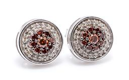 Sale 9253J - Lot 414 - A PAIR OF 10CT WHITE GOLD DIAMOND CLUSTER STUD EARRINGS; each a central cluster of 9 round brilliant cut cognac diamonds (1 chipped)...