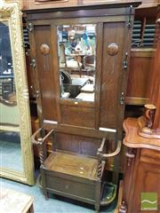 Sale 8416 - Lot 1025 - Edwardian Oak Hall Stand, with hinged seat compartment & stick stands