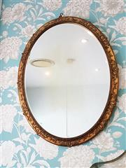Sale 8500A - Lot 30 - An antique French gold leaf gilded decorative oval mirror - Condition: Very good (some ghosting) Measurements: 90cm high x 70cm wid...