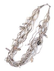 Sale 8928 - Lot 325 - A MULTISTRAND SILVER NECKLACE; 10 strands of articulating crescent bars interspersed with various charms, length 45cm, wt. 125.93g.