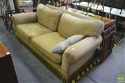 Sale 8251 - Lot 1062 - Upholstered Two and Half Seater Sofa (tear to one arm)