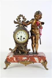 Sale 8905S - Lot 671 - A cherub themed cast mastle clock on rouge marble base. Height 40cm x Width 28cm