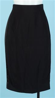 Sale 9090F - Lot 146 - A GIVENCHY PENCIL SKIRT; in black with zip up back and silk lining, size EUR 36
