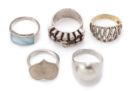 Sale 9124 - Lot 331 - FIVE SILVER RINGS; one set with mother of pearl plaque, other with garnets and white stones (damage), and dome, textured heart and s...