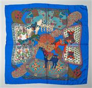 Sale 8740F - Lot 271 - An Hermes Art Des Steppes silk scarf, printed with horses against a blue ground, 86 x 89cm