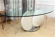 Sale 8703A - Lot 53 - A split globe design dining table with tempered glass top of oval shape resting on two ribbed half spheres and brushed steel support...