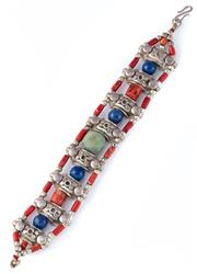 Sale 8928 - Lot 315 - A TRIBAL SILVER STONE SET BRACELET; 3 row bracelet with chevron terminals set with coral, lapis and a central turquoise bead, length...