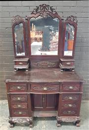 Sale 8956 - Lot 1014 - Early 20th Century Carved Chinese Colonial Mirrored Back Dresser with wing mirrors and eleven drawers, plus two doors around the cen...